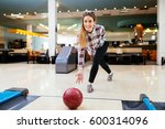 Woman Throwing Bowling Ball In...