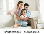 smiing parents and focused... | Shutterstock . vector #600361016