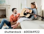 happy father looking at cute... | Shutterstock . vector #600364922