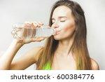 fitness female drinks water   Shutterstock . vector #600384776