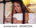 young girl using smartphone in... | Shutterstock . vector #600387356