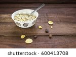 dry oatmeal in a white bowl... | Shutterstock . vector #600413708