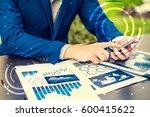 handsome businessman wearing... | Shutterstock . vector #600415622