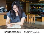 woman working on the table | Shutterstock . vector #600440618