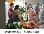 friends having small party at... | Shutterstock . vector #600517106
