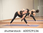 young woman practicing yoga on... | Shutterstock . vector #600529136