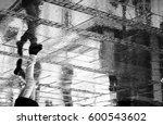a person walking in the city... | Shutterstock . vector #600543602