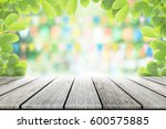 empty wooden table with party... | Shutterstock . vector #600575885