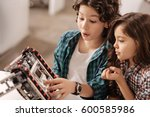 astonished children programming ... | Shutterstock . vector #600585986