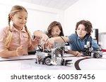 optimistic children working on... | Shutterstock . vector #600587456
