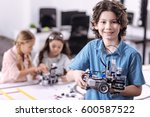 delighted boy holding robot at... | Shutterstock . vector #600587522