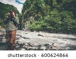 man traveler photographer with... | Shutterstock . vector #600624866
