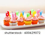 colorful birthday cupcakes with ... | Shutterstock . vector #600629072