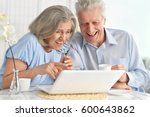elderly couple with a laptop | Shutterstock . vector #600643862