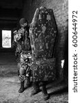 Small photo of Black & white photo of swat soldiers team fighting in ruined building.Military men training with guns & bulletproof shield.Airsoft player train in ruins.Terrorist force attack with assault rifles