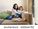 mother and daughter relaxing... | Shutterstock . vector #600666782