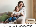 mother and daughter relaxing... | Shutterstock . vector #600666785