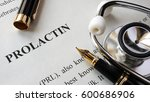 Small photo of Document with title Prolactin on a table.