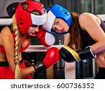 Small photo of Two boxing women workout in fitness class. Sport exercise two female people .Boxer wearing red gloves to box in ring. Feminine obstinacy.