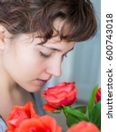 Woman Smelling Red Rose Bouquet ...