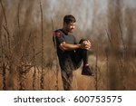 man exercising by the river | Shutterstock . vector #600753575