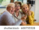 women taking selfie at table.... | Shutterstock . vector #600755528