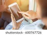 hand holding smart phone | Shutterstock . vector #600767726