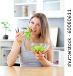 captivating woman eating a... | Shutterstock . vector #60080611