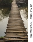 Small photo of Old wooden bridge across the canal.