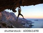 male rock climber gripping...   Shutterstock . vector #600861698