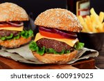 cheeseburgers on wooden table... | Shutterstock . vector #600919025