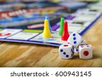 cubes with the game monopoly on ... | Shutterstock . vector #600943145