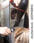styling female hair dryer | Shutterstock . vector #600948842