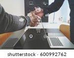 business partnership meeting... | Shutterstock . vector #600992762