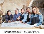 artisans as successful team at... | Shutterstock . vector #601001978