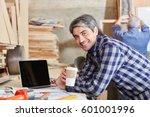 man as carpenter taking a coffe ... | Shutterstock . vector #601001996