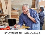 senior artisan calling on the... | Shutterstock . vector #601002116