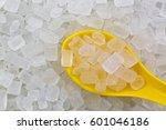 Yellow Spoon Full Of White Roc...