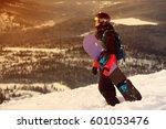 girl snowboarding in the... | Shutterstock . vector #601053476
