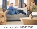 young couple moving in a new... | Shutterstock . vector #601059008