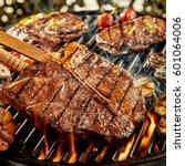tasty marinated t bone steak... | Shutterstock . vector #601064006