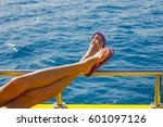 vacationing legs of young woman ... | Shutterstock . vector #601097126