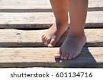 baby legs on the beach | Shutterstock . vector #601134716