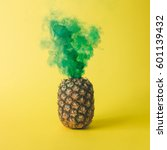 pineapple with green smoke on... | Shutterstock . vector #601139432