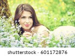 young woman is lying on field... | Shutterstock . vector #601172876