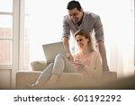 happy couple using laptop... | Shutterstock . vector #601192292