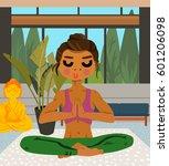 woman practicing yoga in her... | Shutterstock .eps vector #601206098