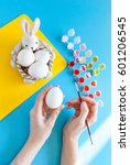person painting easter eggs   Shutterstock . vector #601206545