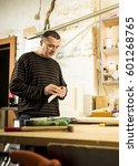 man doing some carpentry work... | Shutterstock . vector #601268765