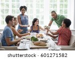 a family gathering for a meal... | Shutterstock . vector #601271582